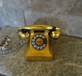 Image used under a Collective Commons License from: https://commons.wikimedia.org/wiki/File:Museo_de_la_Revolucion-Batista_golden_phone.jpg